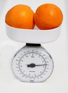oranges on a scale